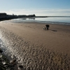 Morecambe beach with dog walkers